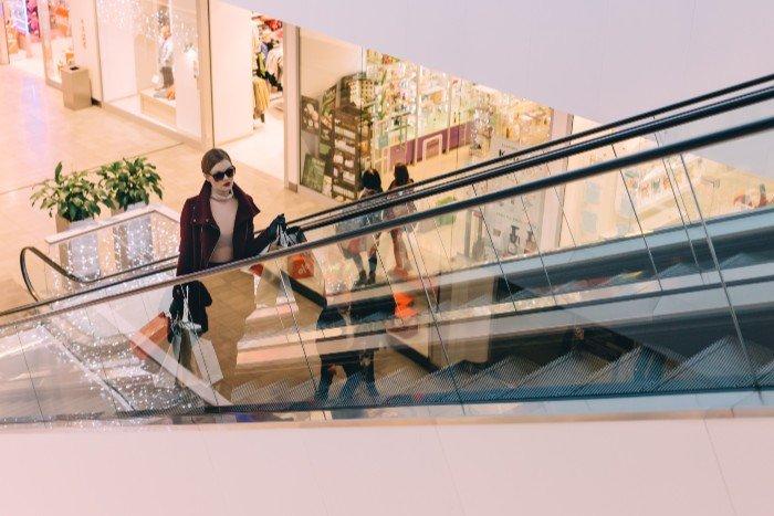woman on an escalator